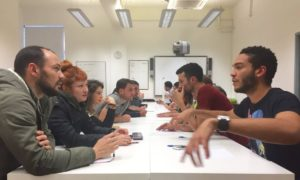 Students from abroad discussing the lesson material