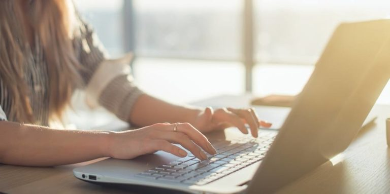 Woman-Typing-on-laptop-computer-job-find