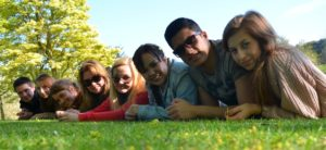 Student group laying photo on a lawn