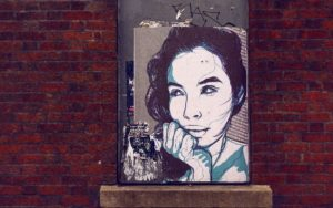 female face on a graffiti wall